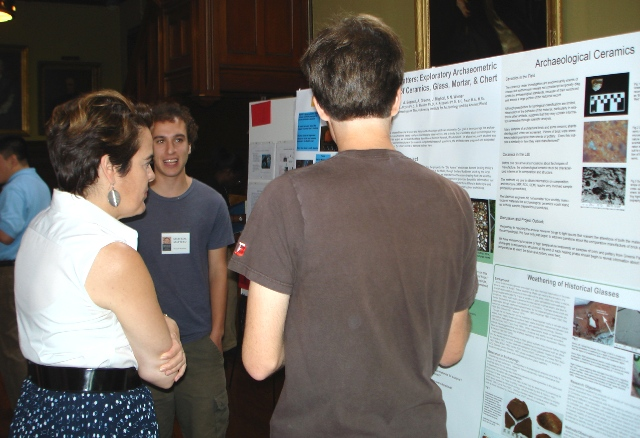 UTRA 2008 students Noah Wiener and Jonathan Migliori discuss their poster with Dean of the College Bergeron.