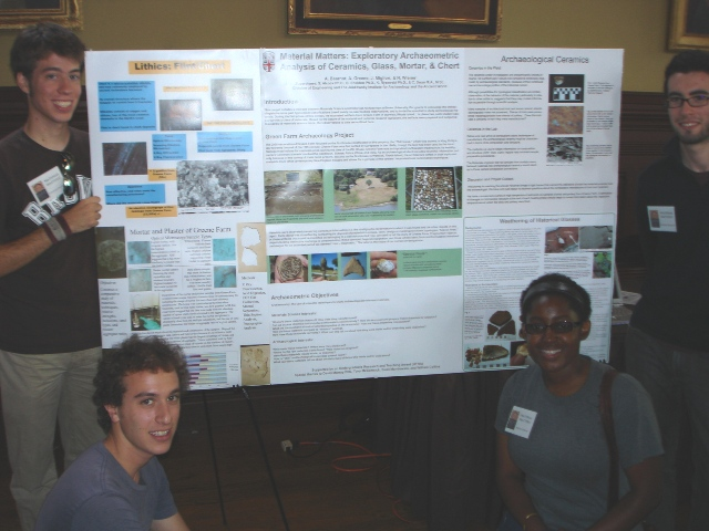 UTRA students Jonathan Migliori, Noah Wiener, Ashley Greene & Andrew Bearnot display their poster at the undergraduate summer research symposium, August 1, 2008.