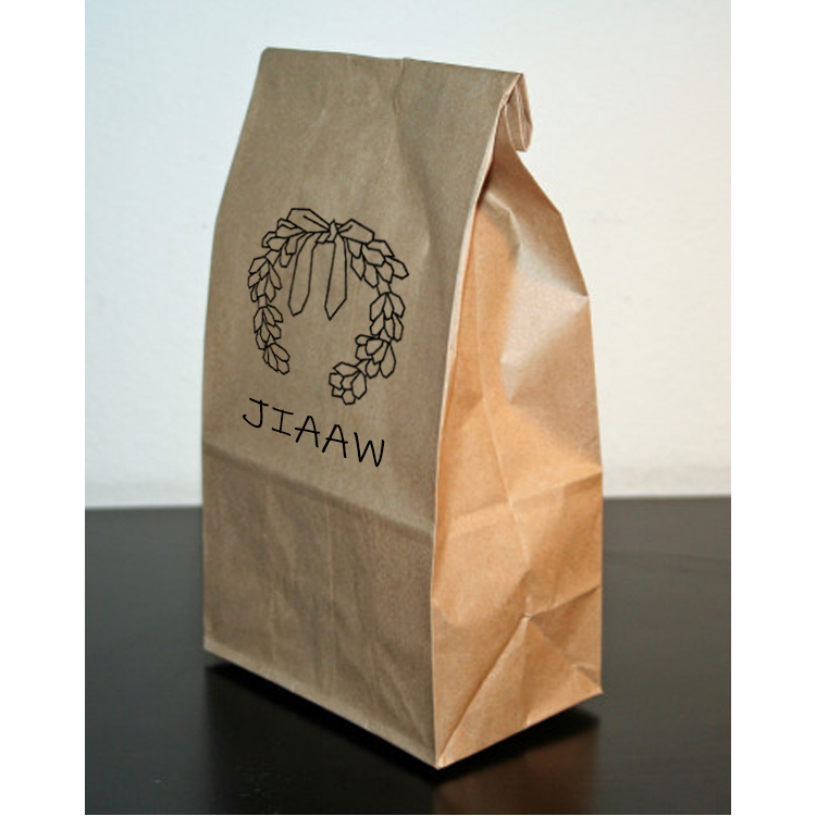 Brown paper bag with the JIAAW logo