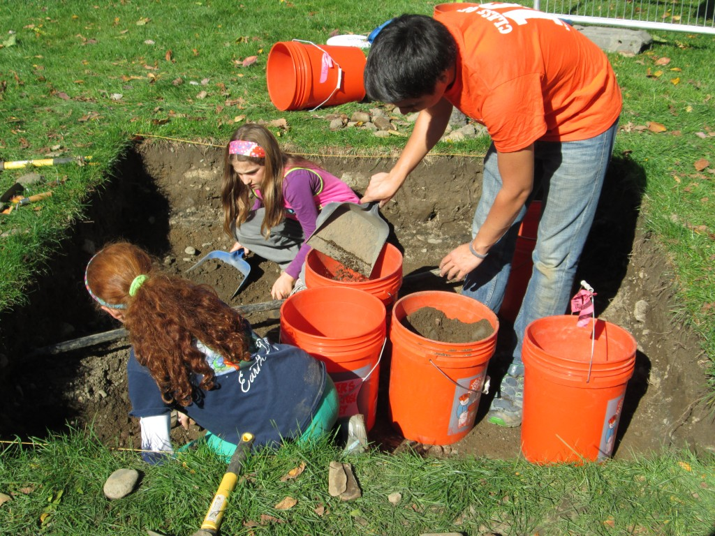 Niyo helping two future archaeologists excavate in QG5