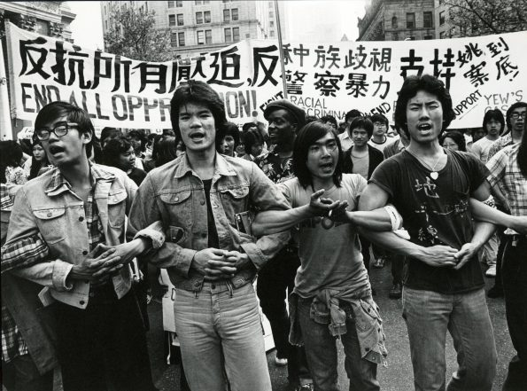 Asian Americans protesting in solidarity against police brutality and racial profiling during the 1970's (photo credit: Corky Lee)