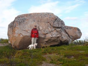With Vili, the archaeology dog, at Varangerfjord, in Norway's Arctic, 2011.
