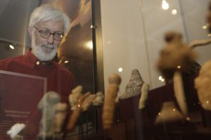 Steven Lubar examining Taino artifacts from the Haffenreffer Museum collection in our Manning Hall gallery.