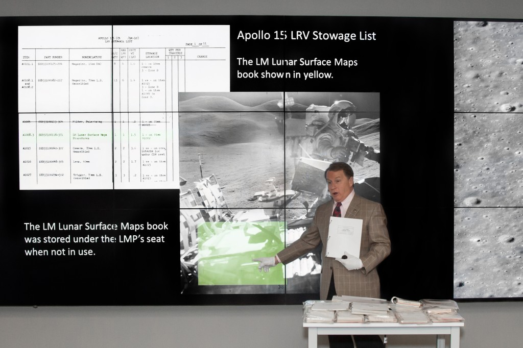Lawrence McGlynn points out the lunar surface maps in a photo of the LRV