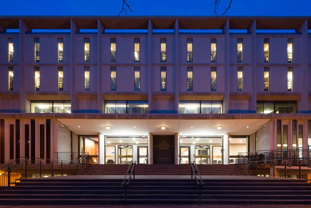 Rockefeller Library facade at dusk