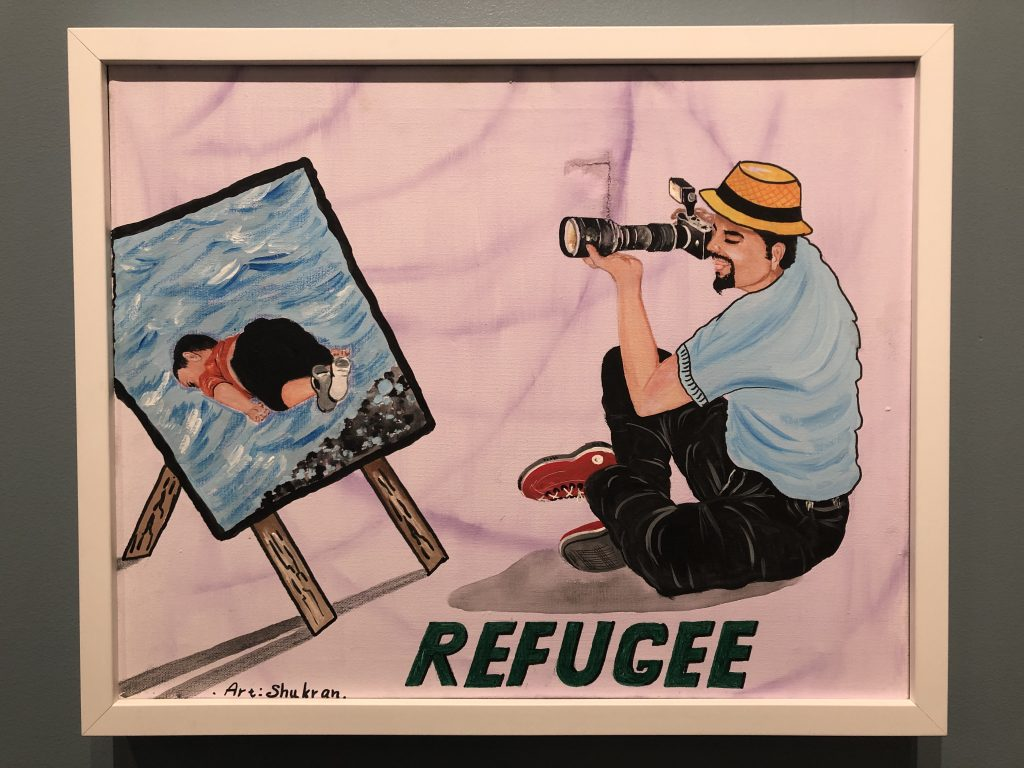 """Photo of painting, of a man taking a photo of a painting, with the word """"Refugee."""""""