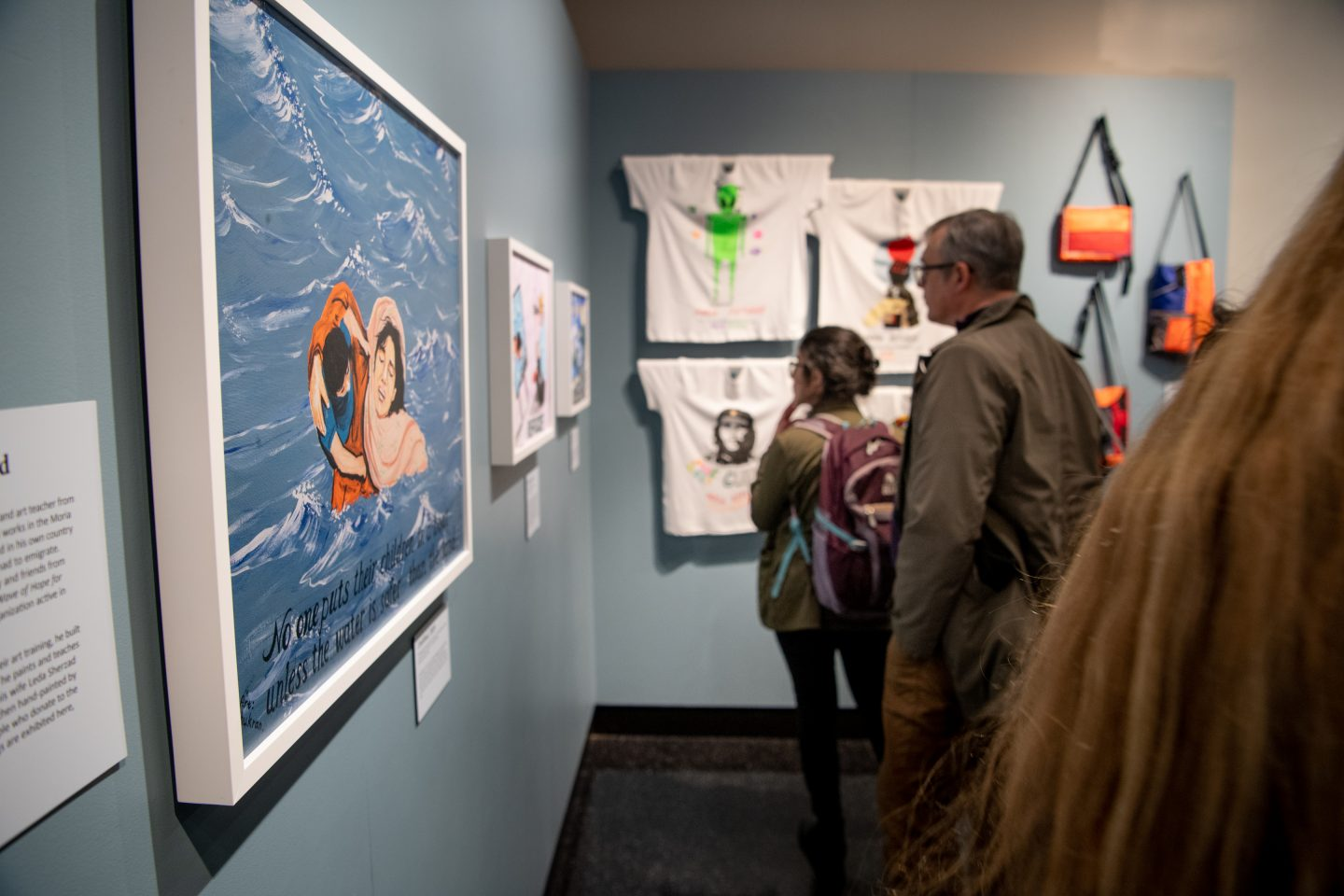 Photo from the exhibit opening of the Art-making section with guests.