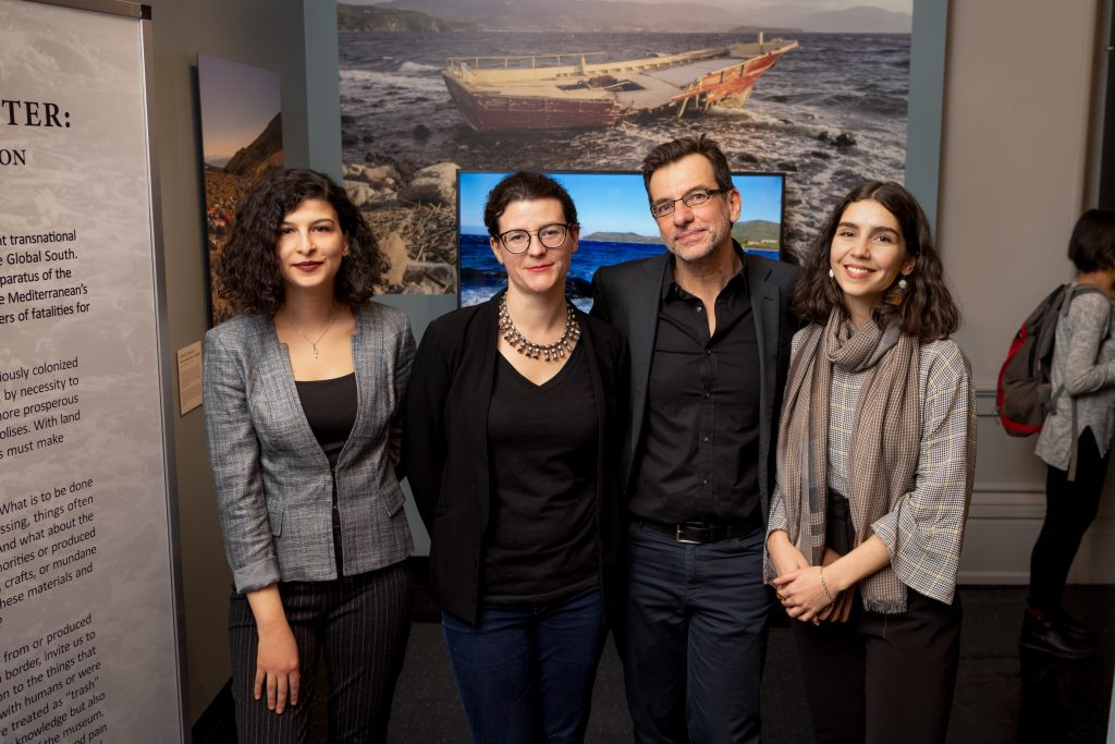 Photo of the four curators at the exhibit opening: Ayşe Şanlı, Laurel Darcy Hackley, Yannis Hamilakis, and Sherena Razek.