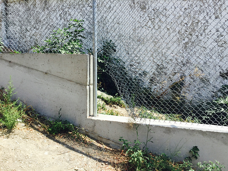 Photo of part of the fence at the rear of Moria Camp.