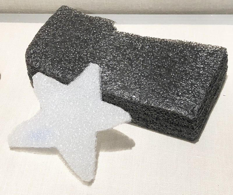 Chunk of black foam and a white foam star, recycled from discarded materials.