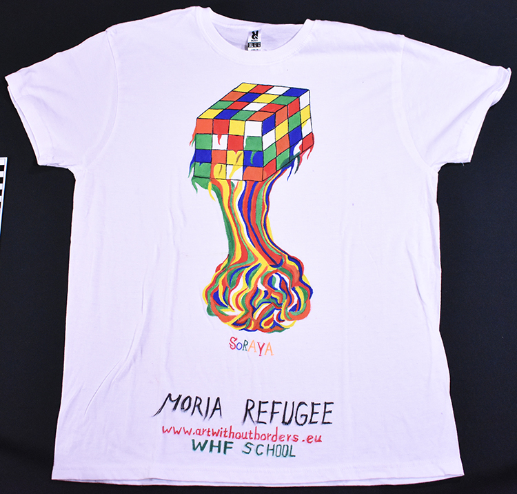 """White t-shirt painted with melting rubik's cube and the words """"Moria Refugee."""""""
