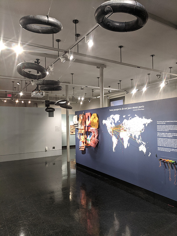 """Photo of inner tubes on display """"floating"""" above the exhibit."""