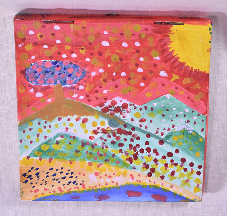 Painting by children of a landscape on the back of a pizza box.