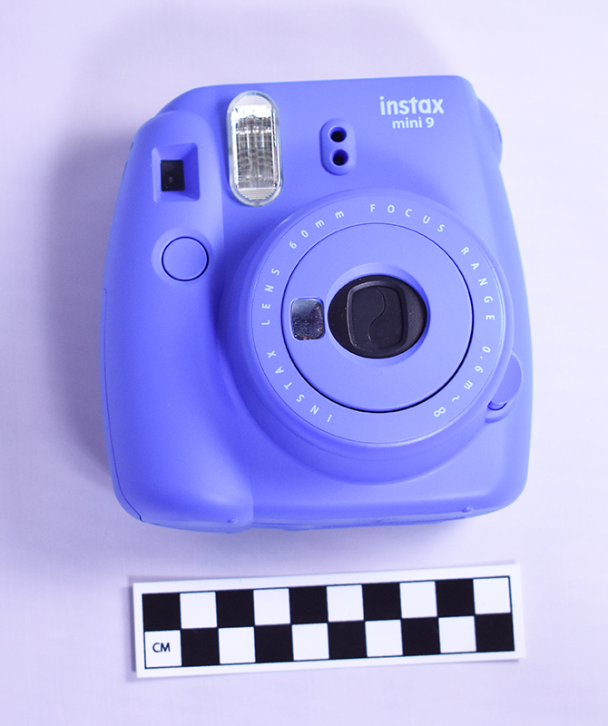 Photo of hand-held polaroid camera.
