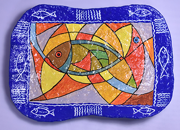 Decorative plate, painted with fish designs, made of plaster and acrylic paint.